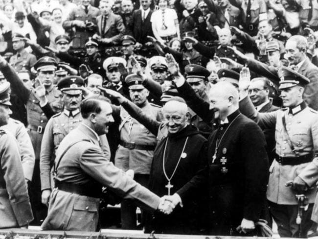 Just a coincidence? Adolf Hitler greeting a crowd of supporters doing the Nazi salute.