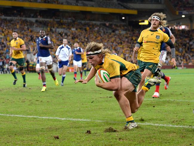 Michael Hooper dives over to score a try during the first Test against France at Suncorp Stadium.