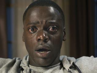 "This image released by Universal Pictures shows Daniel Kaluuya in a scene from, ""Get Out."" ordan Peele's horror sensation is again the subject of debate after it was reported that Universal Pictures has submitted the film for Golden Globes consideration as a comedy, rather than a drama. The film's classification will ultimately reside with the Globes, but the controversy shows how ""Get Out"" is already challenging the conventions of Hollywood's prestige movie season. (Universal Pictures via AP)"