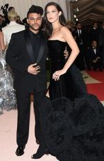 "The Weeknd, left, and Bella Hadid arrive at The Metropolitan Museum of Art Costume Institute Benefit Gala, celebrating the opening of ""Manus x Machina: Fashion in an Age of Technology"" on Monday, May 2, 2016, in New York. Picture: Evan Agostini/Invision/AP"