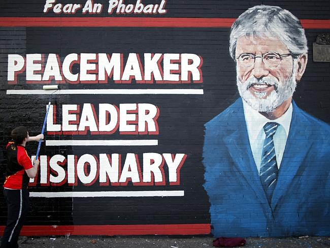 Iconic figure ... a man adds the finishing touch to a newly painted mural of Gerry Adams on the Falls Road, West Belfast, Northern Ireland.