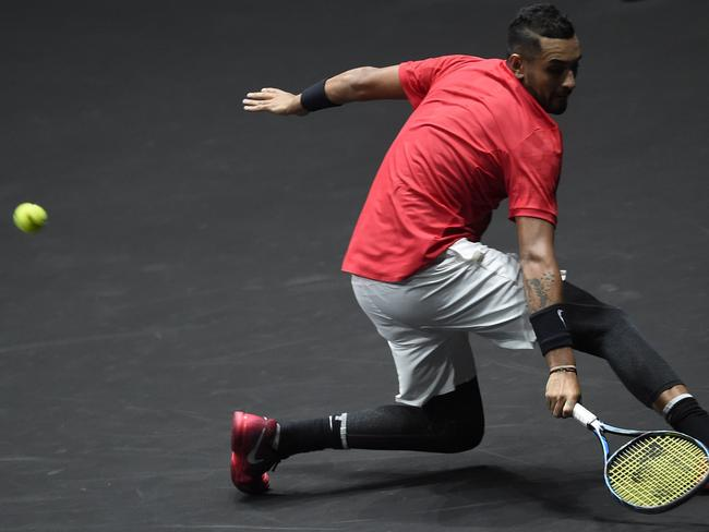 Australian Nick Kyrgios of Team World returns the ball during his match against Team Europe's Tomas Berdych.
