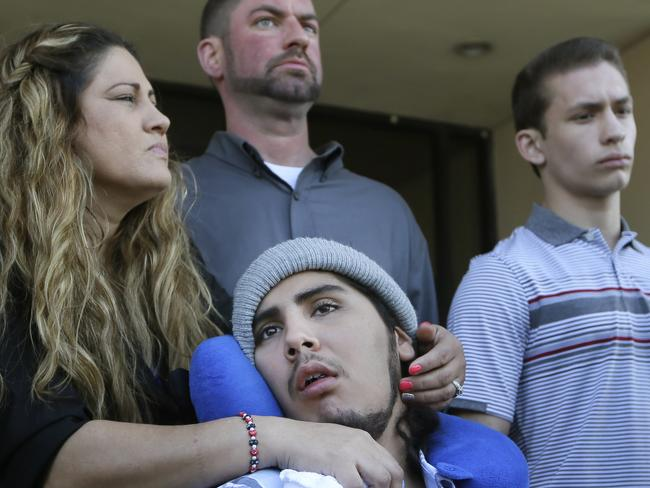 Sergio Molina surrounded by his family. Picture: LM Otero/AP