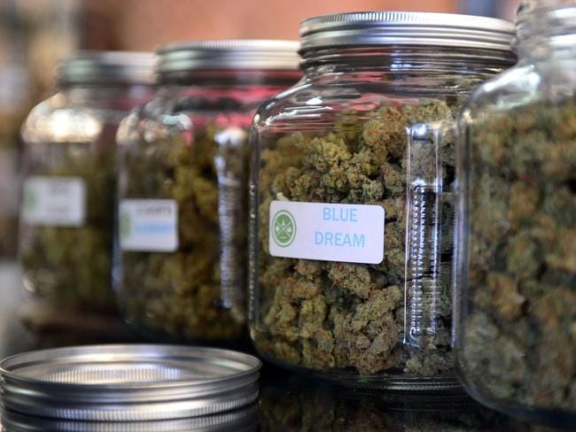 Therapeutic ... medical marijuana is displayed in glass jars at Los Angeles' cannabis farmer's market at the West Coast Collective medical marijuana dispensary. Picture: Frederic J Brown