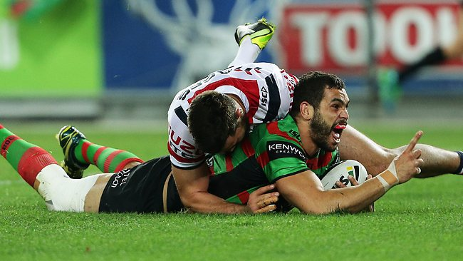 Greg Inglis celebrates a special try. Picture: Brett Costello
