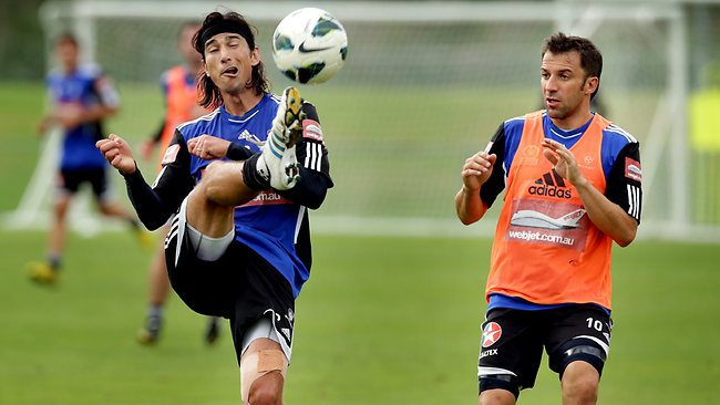 Adam Griffiths (L) clears the ball as Alessandro Del Piero looks on during a training session. Picture: Gregg Porteous