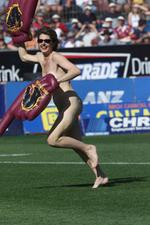 <p>Catherine Maher runs across the field at the Brisbane Broncos vs Sydney Roosters game at ANZ Stadium.</p>