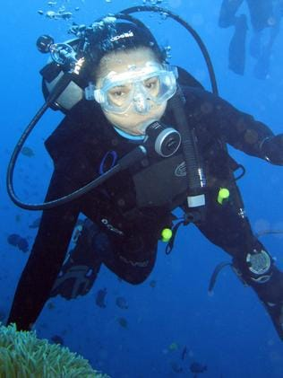 Then-Philippines President Gloria Arroyo scuba diving in 2008 when her health was better. Picture: AFP