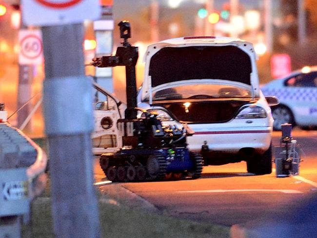 A bomb disposal robot checks out a car in Epping, NSW.