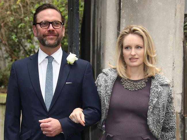 James Murdoch, left, and Kathryn Hufschmid arrive at St Bride's Church. Picture: Joel Ryan/Invision/AP