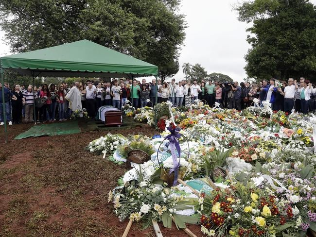 Mourners attend the burial of Chapecoense president Sandro Pallaoro, who died in the crash, in Chapeco, Brazil, on Sunday. Picture: AP/Andre Penner