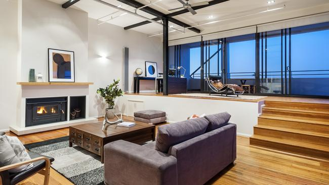 Buyers travelled from Hong Kong to bid on a penthouse which sold for $1.29 million after auction.