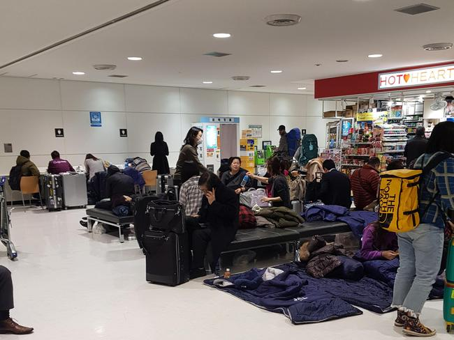 Passengers stranded at Tokyo International Airport. Picture: Supplied