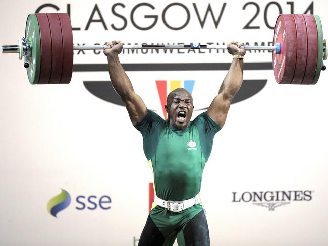 Rawwwr! Simplice Ribouem in the Men's 94kg weightlifting final. Picture: Andy Buchanan