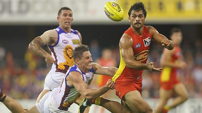 Karmichael Hunt may find the lure of his former code too great if he slips out of Gold Coast's best 22.