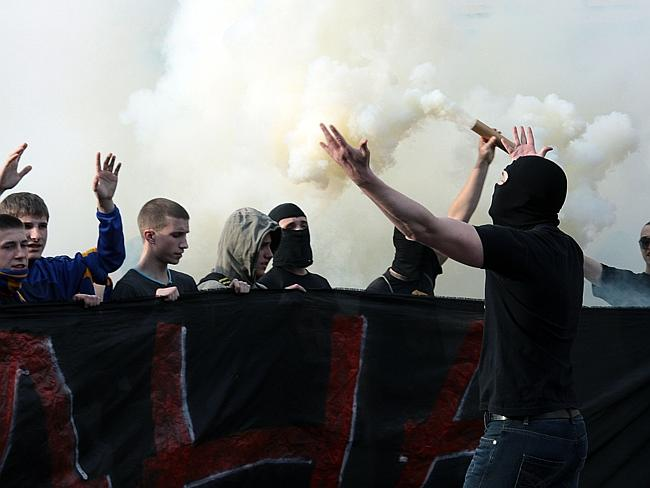 United ... fans of the Metalist and Dnipro football teams come together for the rally in Kharkiv. Picture: Sergey Bobok