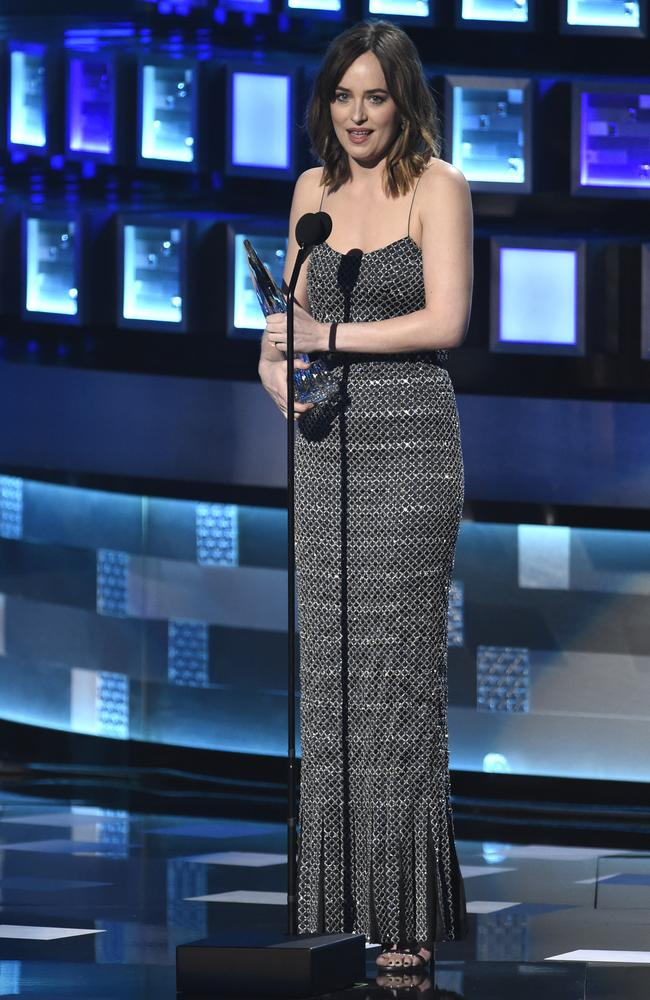 """Dakota Johnson accepts the award for favorite dramatic movie actress for """"Fifty Shades of Grey"""" at the People's Choice Awards. Picture: AP"""