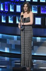 "Dakota Johnson accepts the award for favorite dramatic movie actress for ""Fifty Shades of Grey"" at the People's Choice Awards. Picture: AP"