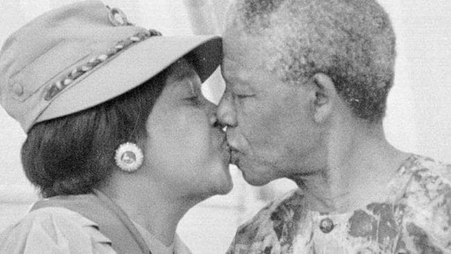 Nelson Mandela kissing wife Winnie at a 1993 Cape Town rally. Picture: AP