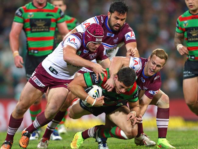 Justin Horo, top, and Daly Cherry-Evans, right, combine in more harmonious fashion during Manly v South Sydney at the SCG on Friday night.