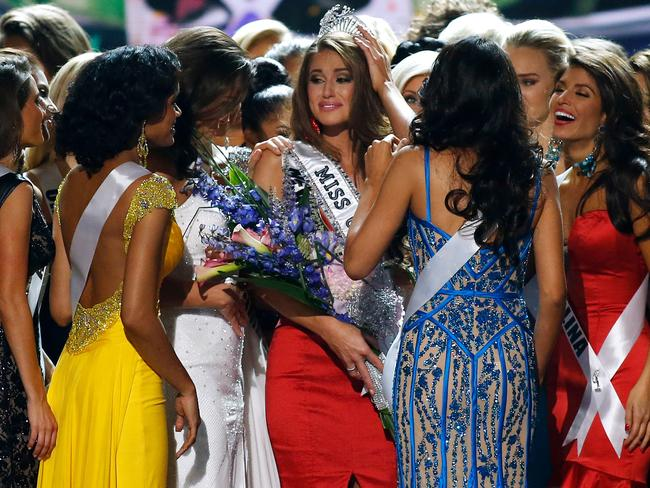 Victorious ... Miss Nevada Nia Sanchez celebrates with her competitors after being crowned Miss USA 2014. Picture: Jonathan Bachman