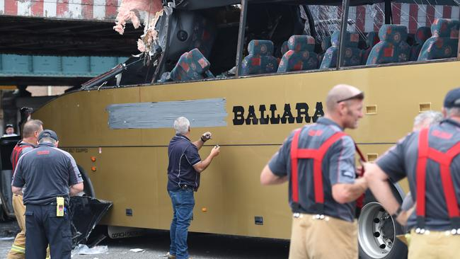 Signage on the bus is covered after the crash. Picture: AAP