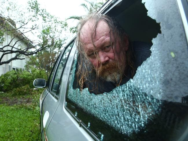 Steven Andrew, 56, with some of the damage Cyclone Debbie caused in Airlie Beach. Photographer: Liam Kidston