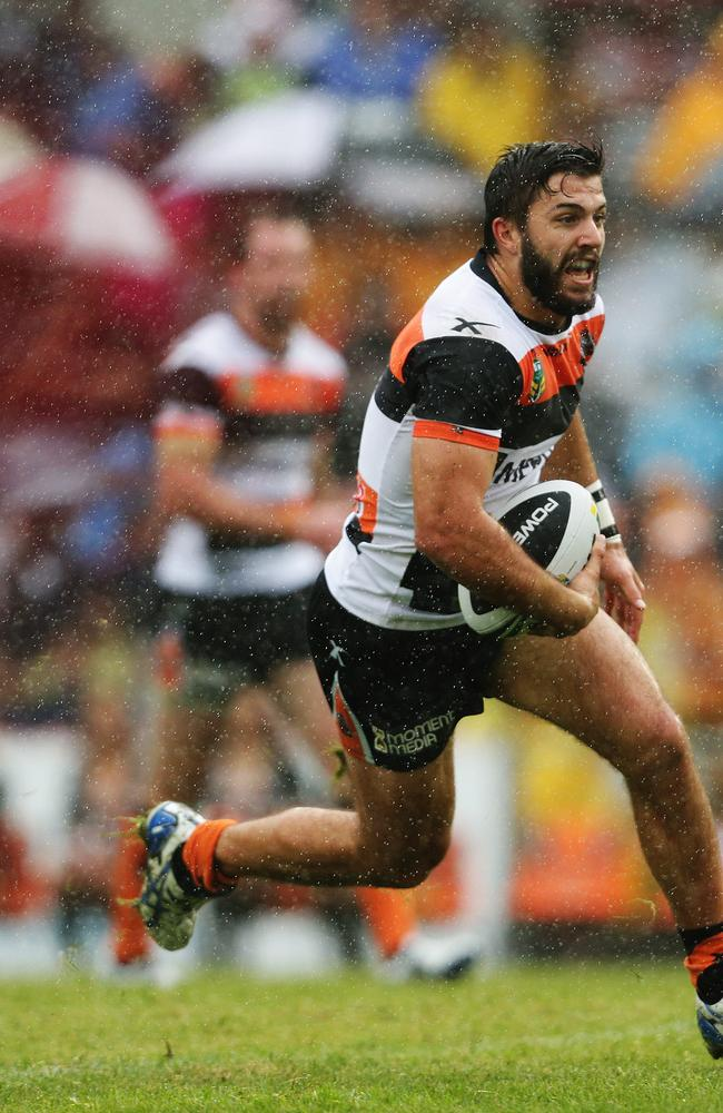 James Tedesco runs the ball for the Tigers against Manly.