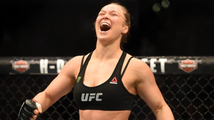 LOS ANGELES, CA - FEBRUARY 28: Ronda Rousey celebrates her victory over Cat Zingano in their UFC women's bantamweight championship bout during the UFC 184 event at Staples Center on February 28, 2015 in Los Angeles, California. (Photo by Harry How/Getty Images)
