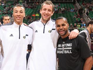 SALT LAKE CITY, UT - FEBRUARY 23: Aron Baynes #16 of the San Antonio Spurs, Dante Exum #11 of the Utah Jazz, Joe Ingles #2 of the Utah Jazz, and Patty Mills #8 of the San Antonio Spurs pose before the game on February 23, 2015 at EnergySolutions Arena in Salt Lake City, Utah. NOTE TO USER: User expressly acknowledges and agrees that, by downloading and or using this photograph, User is consenting to the terms and conditions of the Getty Images License Agreement. Mandatory Copyright Notice: Copyright 2015 NBAE (Photo by Melissa Majchrzak/NBAE via Getty Images)