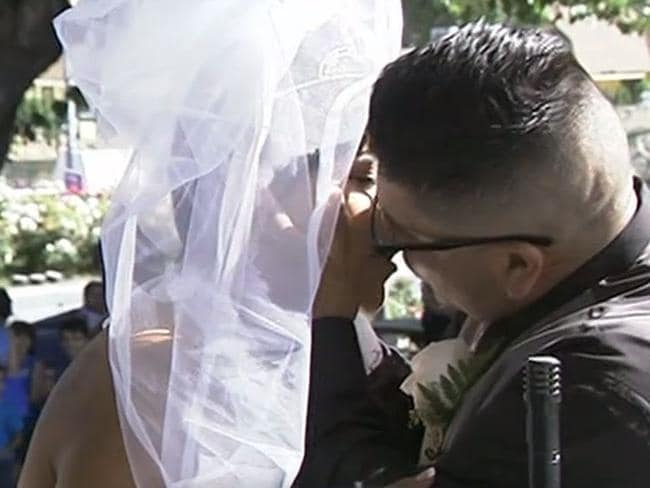 Never giving up... Alma Fragoso and Juan Franco share their first kiss as a married couple. Picture: ABC News US