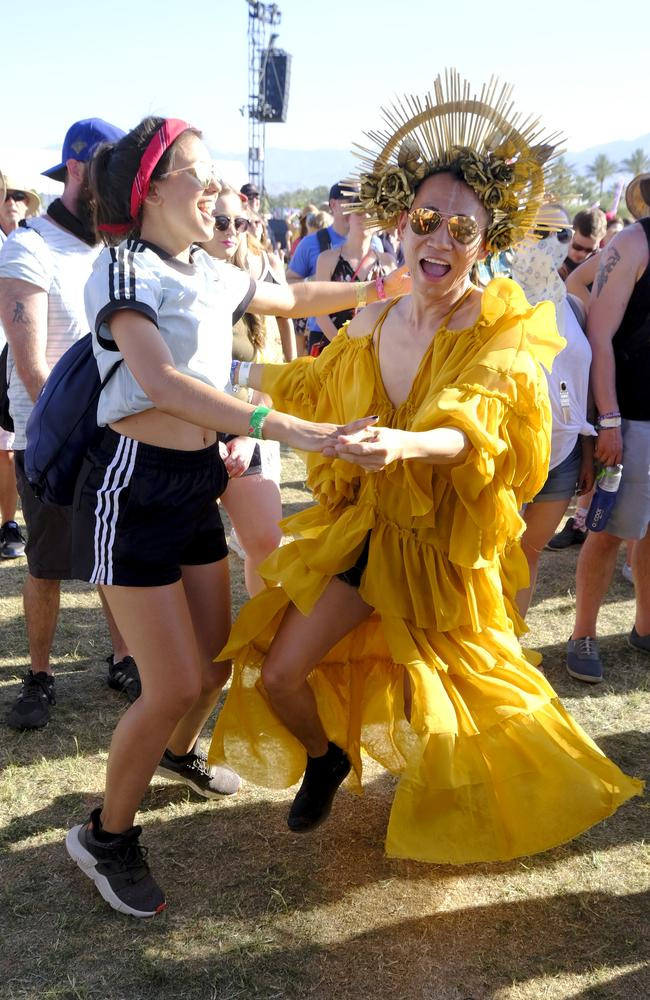 On the left: The only normally dressed person at Coachella. Picture: Frazer Harrison/Getty Images for Coachella