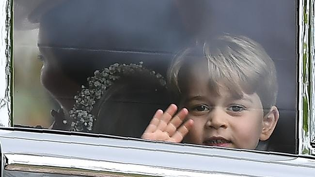 Back to his cheeky best. Prince George waves as he leaves in a car after attending the wedding of his aunt, Pippa Middleton, to James Matthews. AFP PHOTO / POOL / Justin TALLIS