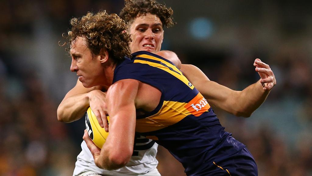 Matt Priddis tries to charge past Charlie Curnow. Picture: Getty Images