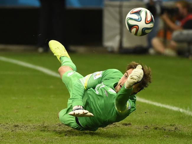 Netherlands goalkeeper Tim Krul saves a penalty by Costa Rica's Michael Umana during the penalty shootout.