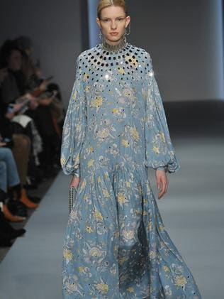 A model wears a floral print at the fashion show. Picture: Getty