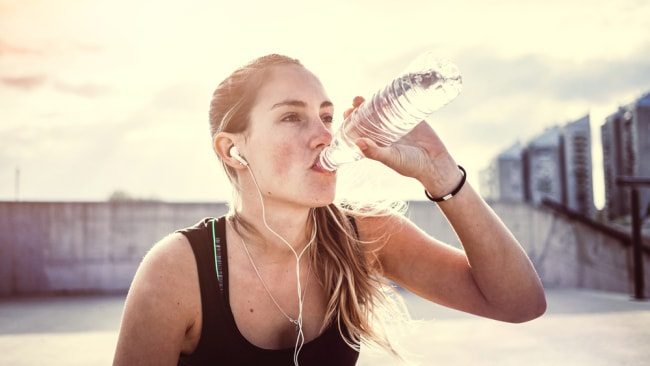 Do you drink too much water at the gym turns out youve been drinking your water at the gym wrong sciox Choice Image