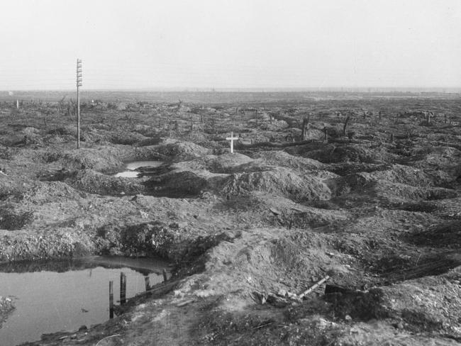 The lonely cross on the barren landscape at Pozieres, marking the grave of Tasmanian soldier Captain Ivor Margetts killed in action on July 24, 1916. The grave was later obliterated by the Germans. Picture: Australian War Memorial/E00532