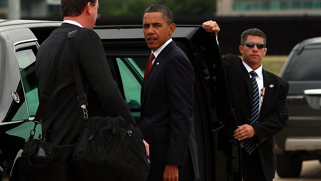 US President Barack Obama gets into his personal armoured vehicle - known as 'The Beast' - after arriving in Canberra. Picture: Stuart McEvoy