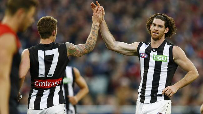 Collingwood's Tyson Goldsack and Dayne Beams celebrate their scrappy victory over Melbourne. Picture: Michael Klein