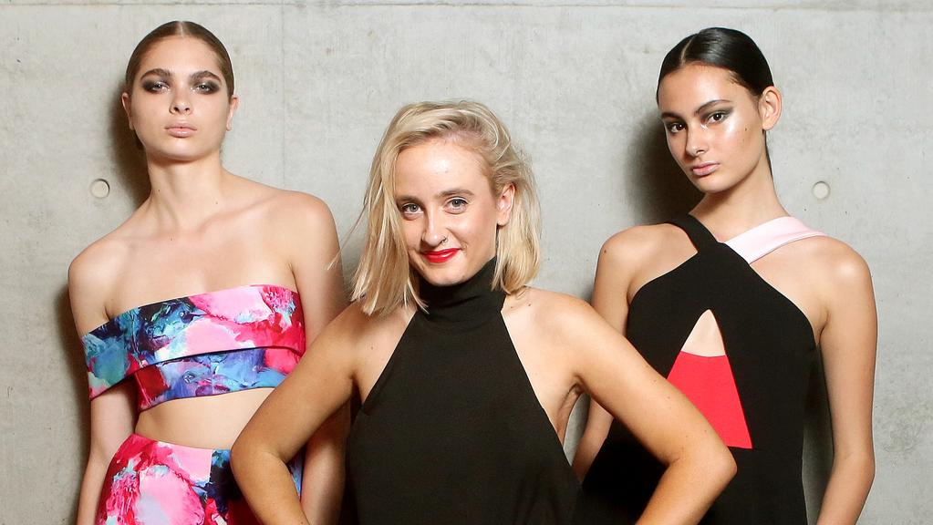 Fashion designer Stacey Hendrickson with models Sharnee Gates and Paige Rivas wearing her designs at Australian Fashion Week 2015.
