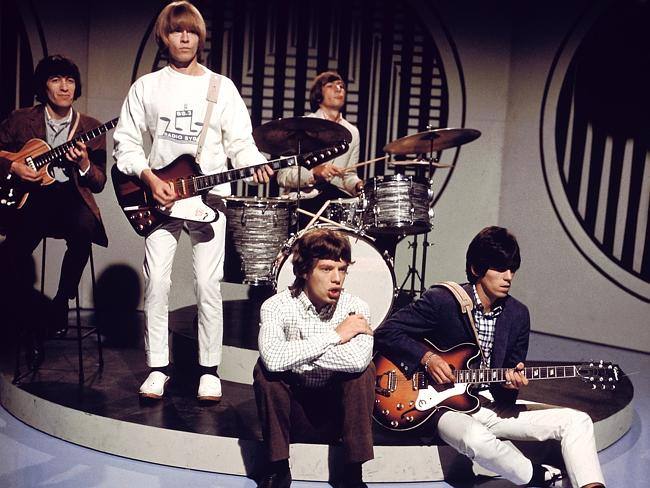 When they first began ... The Rolling Stones (left to right) Bill Wyman, Brian Jones, Mick Jagger, Charlie Watts (behind), Keith Richards (playing Epiphone guitar), on the set of TV show. Picture: David Redfern
