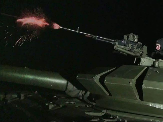 Testing times ... a video grab taken from the Russian TV channel shows Russian paratroopers taking part in a night drill, 150km outside Russian southern town of Rostov-on-Don, a region next to the Ukrainian border.