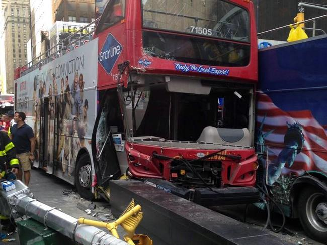 Lucky escape ... A Twitter photo of two double decker buses that collided in New York City's Times Square.