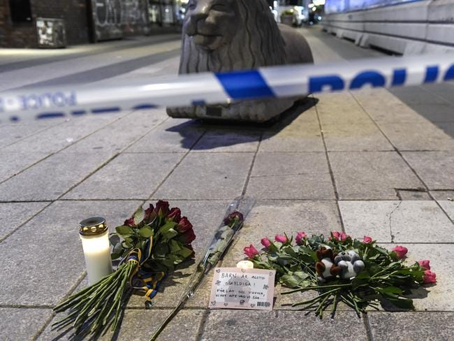 Candles and flowers laid at the scene of the attack. Picture: AP