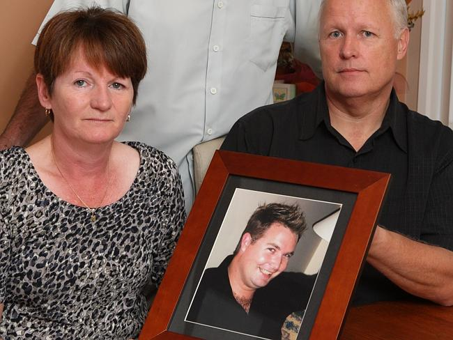 Tragedy ... Matthew Fuller's parents pose with a photo of their son who was killed while installing insulation.