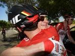 Andre Greipel celebrates with his team mate. Picture: Daniel Kalisz/Getty Images