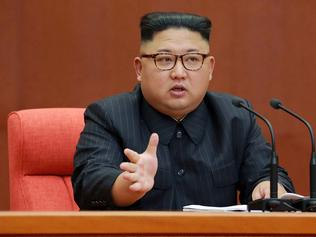 """This photo taken on October 7, 2017 and released on October 8, 2017 by North Korea's official Korean Central News Agency (KCNA) shows North Korean leader Kim Jong-Un attending the Second Plenum of the 7th Central Committee of the Workers' Party of Korea (WPK) in Pyongyang. / AFP PHOTO / KCNA VIA KNS / STR / South Korea OUT / REPUBLIC OF KOREA OUT ---EDITORS NOTE--- RESTRICTED TO EDITORIAL USE - MANDATORY CREDIT """"AFP PHOTO/KCNA VIA KNS"""" - NO MARKETING NO ADVERTISING CAMPAIGNS - DISTRIBUTED AS A SERVICE TO CLIENTS THIS PICTURE WAS MADE AVAILABLE BY A THIRD PARTY. AFP CAN NOT INDEPENDENTLY VERIFY THE AUTHENTICITY, LOCATION, DATE AND CONTENT OF THIS IMAGE. THIS PHOTO IS DISTRIBUTED EXACTLY AS RECEIVED BY AFP. /"""