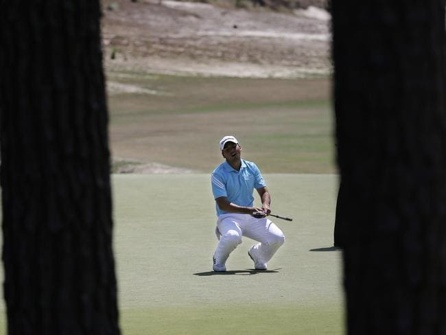 Jason Day, of Australia, reacts after missing a putt on the fourth hole during the final round of the U.S. Open.