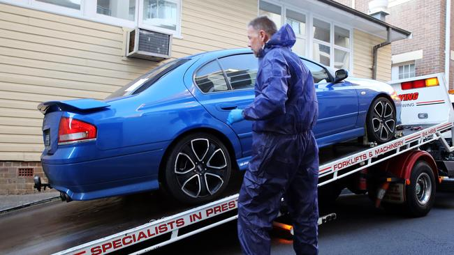 Former detective Glen McNamara's car being taken away from Kogarah Police Station / Picture Craig Greenhill